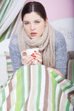 Sick woman with temperature resting. Royalty Free Stock Images