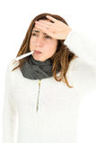 Sick woman with a thermometer in her mouth Royalty Free Stock Image