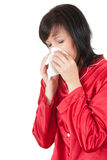 Sick woman with tissue blowing her nose Royalty Free Stock Image