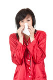 Sick woman with tissue blowing her nose Royalty Free Stock Photo