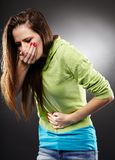 Sick woman about to throw up holding her stomach Stock Photography