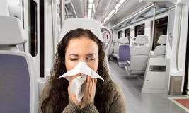 Sick woman travelling by train royalty free stock photo