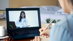 Sick woman use video conference, make online consultation with doctor on notebook computer, patient ask doctor about illness
