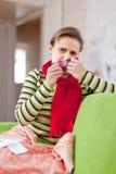 Sick woman uses handkerchief. In home Stock Photo
