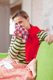 Sick woman uses handkerchief Royalty Free Stock Photos