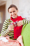 Sick woman uses handkerchief Royalty Free Stock Images