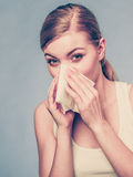 Sick woman using paper tissue, headcold problem Royalty Free Stock Photography