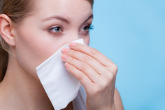 Sick woman using paper tissue, headcold problem. Disease, sickness, allergy, malady problem concept. Woman wiping her nose with hygienic paper tissue having cold Royalty Free Stock Photos