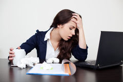 Sick woman at work Stock Photo