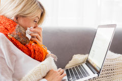 Sick woman working from home Stock Photo