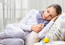 Sick Woman. A young girl is sick Royalty Free Stock Photo