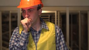Sick worker or an engineer or architect coughing on construction site, Cough. Concept: construction, worker, engineering, design, health stock video footage