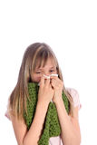 Sick, young girl  blows her nose Stock Image