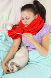 Sick Young Girl In Red Scarf Royalty Free Stock Photos