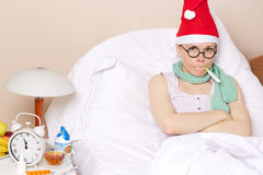 Sick young lady in her bed. During new years day celebration Stock Photo