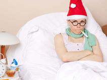 Sick young lady in her bed. During new years day celebration Stock Photography