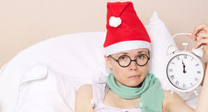 Sick young lady in her bed. During new years day celebration Royalty Free Stock Photos