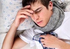 Sick Young Man. In the Bed at the Home Royalty Free Stock Photos