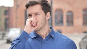 Sick Young Man Coughing while Standing Outdoor. 4k high quality, 4k high quality stock footage