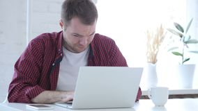 Sick Young Man Coughing and Working on Laptop, Throat infection stock footage