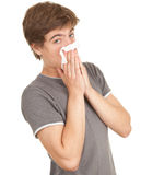 Sick young man with flu. Blowing her nose, series Royalty Free Stock Image