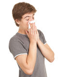 Sick young man with flu. Blowing her nose, series Royalty Free Stock Photo