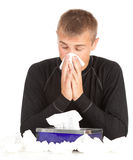 Sick young man with flu. Blowing her nose Royalty Free Stock Photography