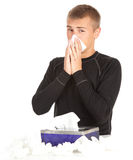 Sick young man with flu. Blowing her nose, series Stock Image