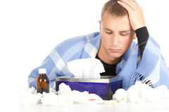 Sick young man with flu. Blowing her nose Stock Photo