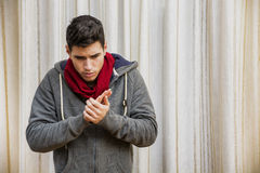 Sick young man with flu or cold wearing scarf Royalty Free Stock Image