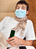 Sick Young Man in Flu Mask Stock Images