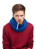 Sick young man holding thermometer Stock Images