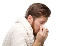 Sick young man holding wipes, profile view Stock Images