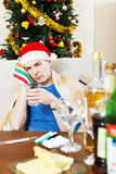 Sick young man with hungover holding glass of water Stock Photo