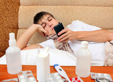 Sick Young Man with the Phone Stock Images