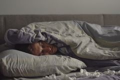 Sick young man is sleep in bed, covered in a blanket Royalty Free Stock Photo