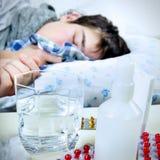 Sick Young Man sleep Stock Photo
