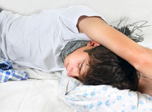 Sick Young Man sleeping Royalty Free Stock Photography