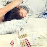 Sick Young Man sleeping Stock Image