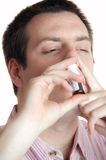 Sick young man taking nose drops Stock Photography