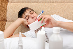 Sick Young Man with Thermometer Royalty Free Stock Photography