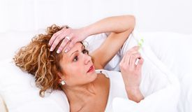Sick young woman Stock Image