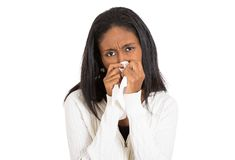 Sick young woman with allergy, germs, cold, blowing nose Stock Images