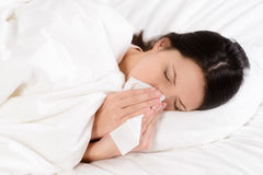 Free Sick Young Woman Blowing Her Nose On A Tissue Stock Image - 39378201