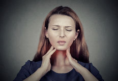 Sick young woman having pain in her throat Stock Photography