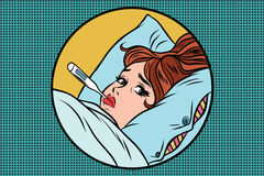 Sick young woman lying in bed with thermometer Stock Photo