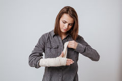 Sick young woman with the plaster on hand Royalty Free Stock Image
