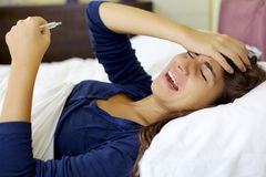 Sick young woman shouting because of strong pain Stock Photography