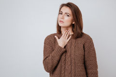 Sick young woman touching her neck. Stock Photography
