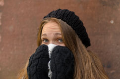 Sick Young Woman in Winter Attire Blowing her Bose Stock Photography